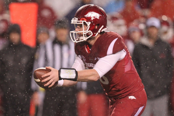 Nov 22, 2014; Fayetteville, AR, USA; Arkansas Razorbacks quarterback Austin Allen (8) looks to hand off during the game against the Ole Miss Rebels at Donald W. Reynolds Razorback Stadium. Arkansas defeated Mississippi 30-0. Mandatory Credit: Nelson Chenault-USA TODAY Sports