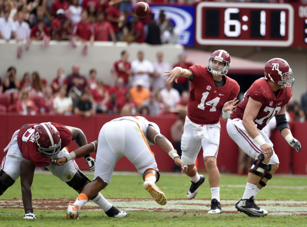 Oct 24, 2015; Tuscaloosa, AL, USA; Alabama Crimson Tide quarterback Jake Coker (14) passing against the Tennessee Volunteers during the second quarter at Bryant-Denny Stadium. Mandatory Credit: John David Mercer-USA TODAY Sports