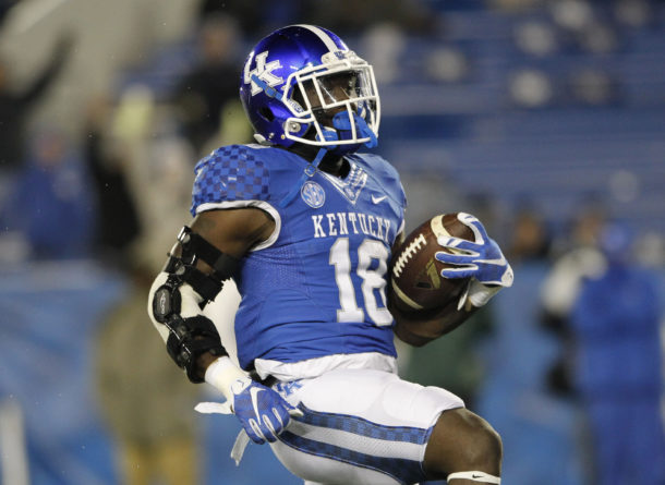 Nov 21, 2015; Lexington, KY, USA; Kentucky Wildcats running back Stanley Boom Williams (18) runs the ball for a touchdown against the Charlotte 49ers in the second hafl at Commonwealth Stadium. Mandatory Credit: Mark Zerof-USA TODAY Sports