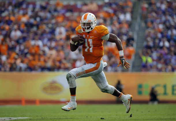 Jan 1, 2016; Tampa, FL, USA; Tennessee Volunteers quarterback Joshua Dobbs (11) runs the ball in for a touchdown against the Northwestern Wildcats during the second half in the 2016 Outback Bowl at Raymond James Stadium. Tennessee Volunteers defeated the Northwestern Wildcats 45-6. Mandatory Credit: Kim Klement-USA TODAY Sports