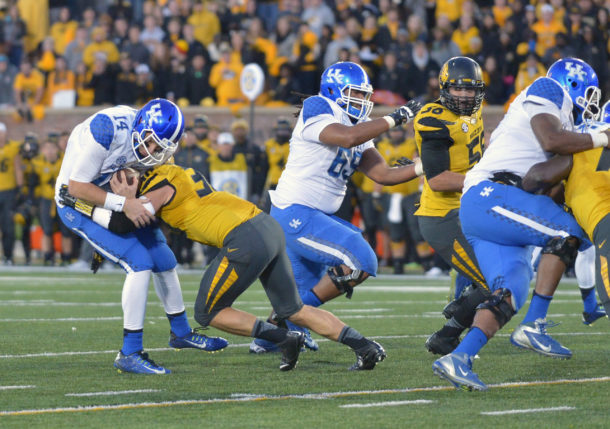 Nov 1, 2014; Columbia, MO, USA; Kentucky Wildcats quarterback Patrick Towles (14) is tackled by Missouri Tigers linebacker Michael Scherer (30) during the second half at Faurot Field. Missouri won 20-10. Mandatory Credit: Denny Medley-USA TODAY Sports