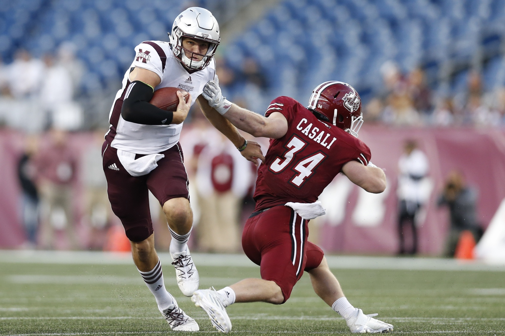 Sep 24, 2016; Foxborough, MA, USA; Mississippi State Bulldogs quarterback Nick Fitzgerald (7) evades a tackle by Massachusetts Minutemen line backer Steve Casali (34) during the third quarter at Gillette Stadium. Mississippi State won 47-35. Credit: Greg M. Cooper-USA TODAY Sports