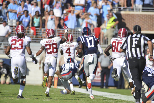 Sep 17, 2016; Oxford, MS, USA; Alabama Crimson Tide played react as defensive back Eddie Jackson (4) returns an interception for a touchdown the second quarter of the game against the Mississippi Rebels at Vaught-Hemingway Stadium. Alabama won 48-43. Mandatory Credit: Matt Bush-USA TODAY Sports