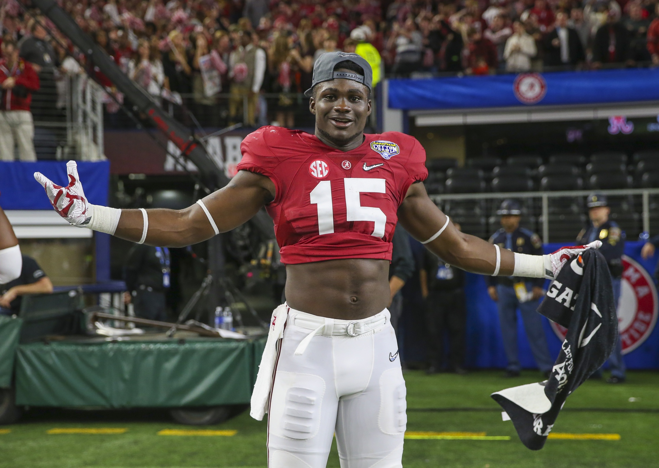 Dec 31, 2015; Arlington, TX, USA; Alabama Crimson Tide defensive back Ronnie Harrison (15) celebrates after the victory against the Michigan State Spartans in the 2015 CFP semifinal at the Cotton Bowl at AT&T Stadium. Mandatory Credit: Kevin Jairaj-USA TODAY Sports