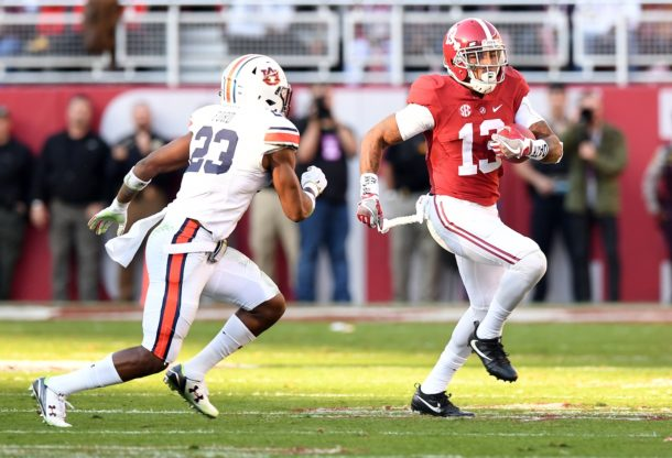 Nov 26, 2016; Tuscaloosa, AL, USA; Alabama Crimson Tide wide receiver ArDarius Stewart (13) carries Auburn Tigers defensive back Johnathan Ford (23) during the first quarter at Bryant-Denny Stadium. Mandatory Credit: John David Mercer-USA TODAY Sports