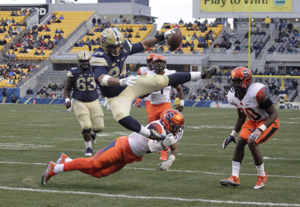 Nov 26, 2016; Pittsburgh, PA, USA; Pittsburgh Panthers running back James Conner (24) hurdles Syracuse Orange defensive back Rodney Williams (6) into the end-zone for a touchdown during the second quarter at Heinz Field. Mandatory Credit: Charles LeClaire-USA TODAY Sports