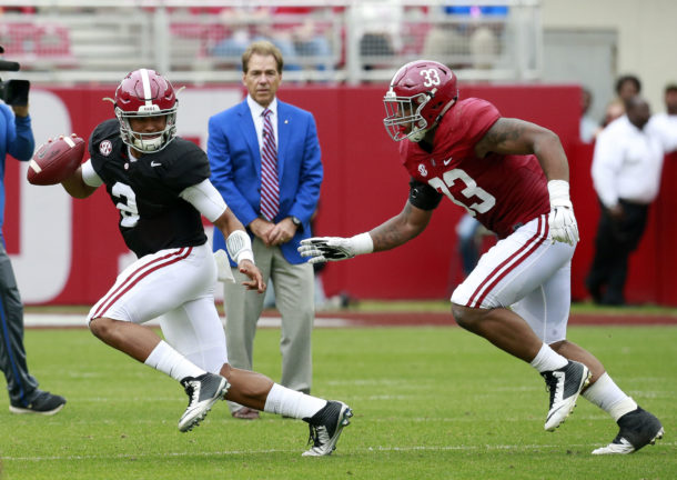 Apr 16, 2016; Tuscaloosa, AL, USA; Alabama Crimson Tide quarterback Jalen Hurts (2) scrambles from Alabama Crimson Tide linebacker Anfernee Jennings (33) as Alabama Crimson Tide head coach Nick Saban looks on at Bryant-Denny Stadium. Mandatory Credit: Marvin Gentry-USA TODAY Sports