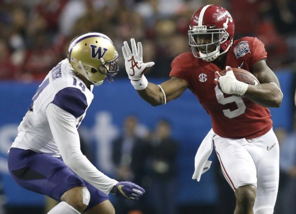 Dec 31, 2016; Atlanta, GA, USA; Alabama Crimson Tide running back Bo Scarbrough (9) runs against Washington Huskies defensive back Jojo McIntosh (14) during the second quarter in the 2016 CFP semifinal at the Peach Bowl at the Georgia Dome. Mandatory Credit: Brett Davis-USA TODAY Sports