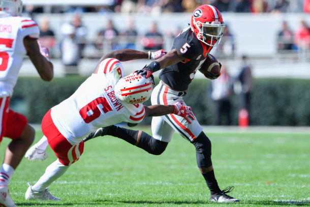 Nov 19, 2016; Athens, GA, USA; Georgia Bulldogs wide receiver Terry Godwin (5) runs against Louisiana-Lafayette Ragin Cajuns defensive back Savion Brown (6) during the first half at Sanford Stadium. Mandatory Credit: Dale Zanine-USA TODAY Sports