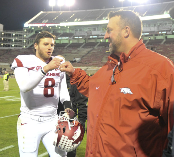 Nov 19, 2016; Starkville, MS, USA; Arkansas Razorbacks quarterback Austin Allen (8) and Razorbacks head coach Bret Bielema react after the game against the Mississippi State Bulldogs at Davis Wade Stadium. Arkansas defeated Mississippi State 58-42. Mandatory Credit: Justin Ford-USA TODAY Sports