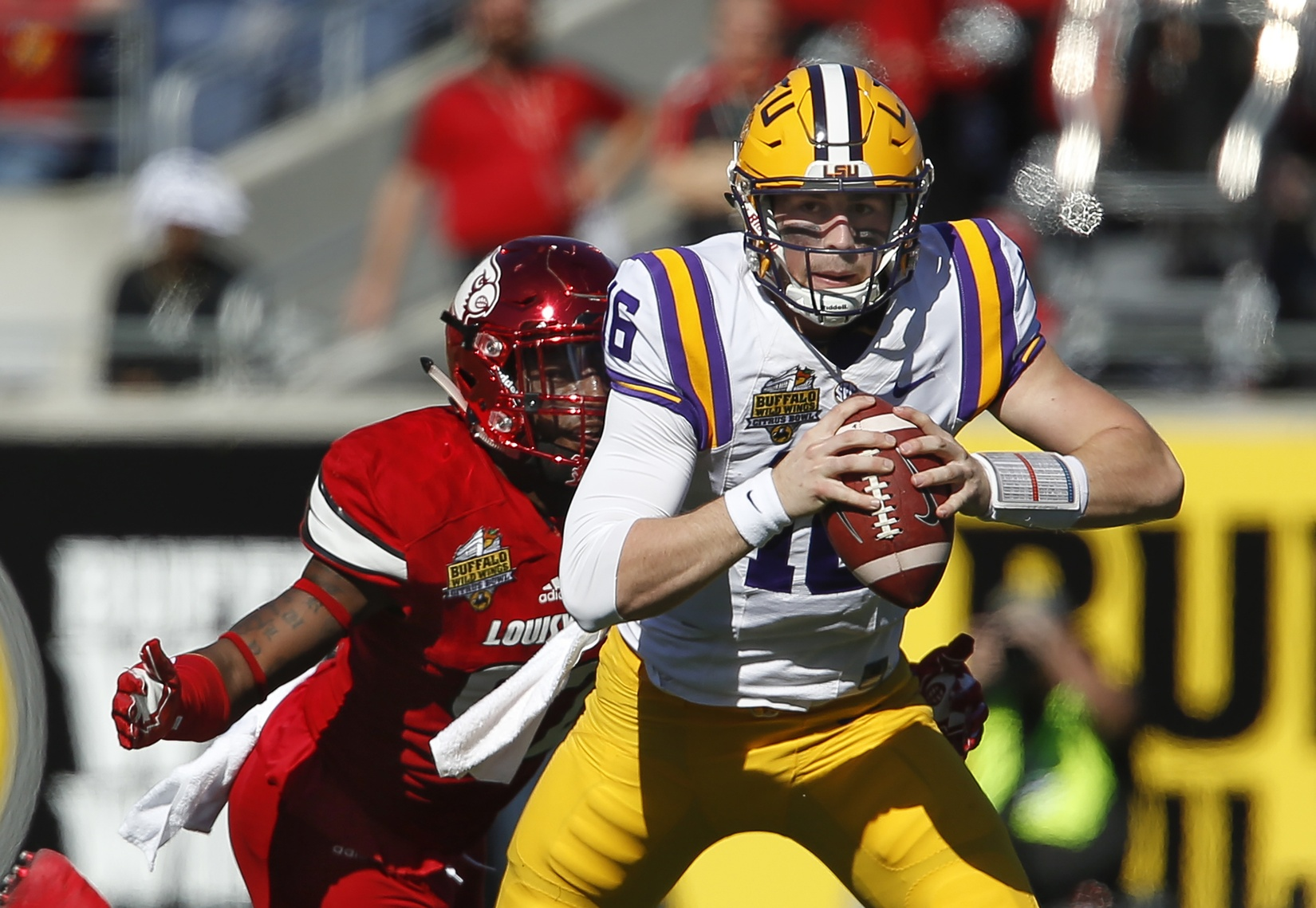 Dec 31, 2016; Orlando, FL, USA; LSU Tigers quarterback Danny Etling (16) is sacked by Louisville Cardinals linebacker Devonte Fields (92) during the first quarter of an NCAA football game in the Buffalo Wild Wings Citrus Bowl at Camping World Stadium. Mandatory Credit: Reinhold Matay-USA TODAY Sports