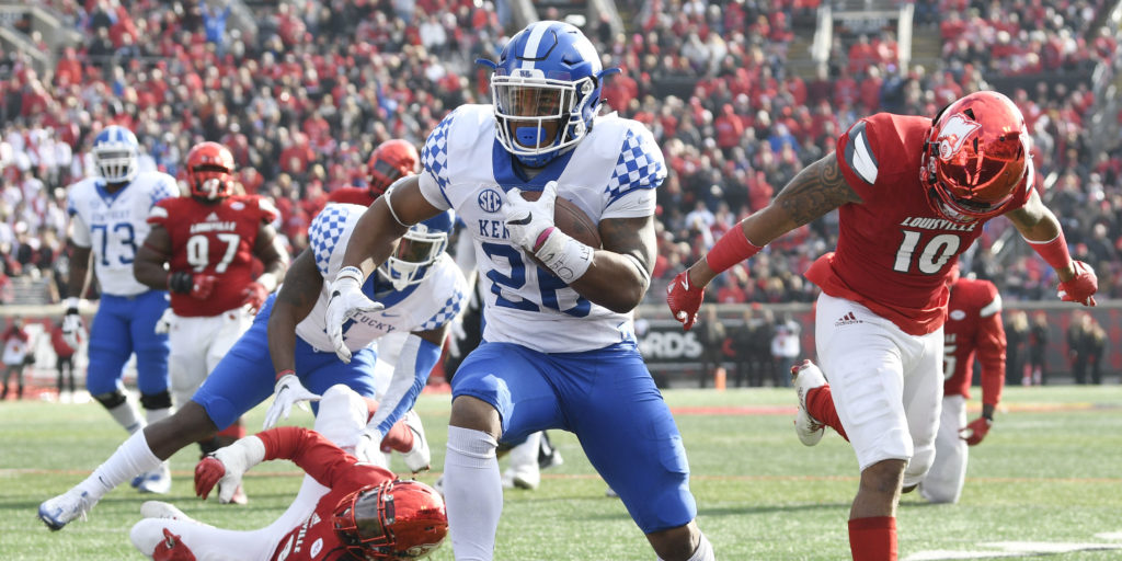 Nov 26, 2016; Louisville, KY, USA; Kentucky Wildcats running back Benny Snell Jr. (26) scores a touchdown against the Louisville Cardinals during the second quarter at Papa John's Cardinal Stadium. Kentucky defeated Louisville 41-38. Mandatory Credit: Jamie Rhodes-USA TODAY Sports