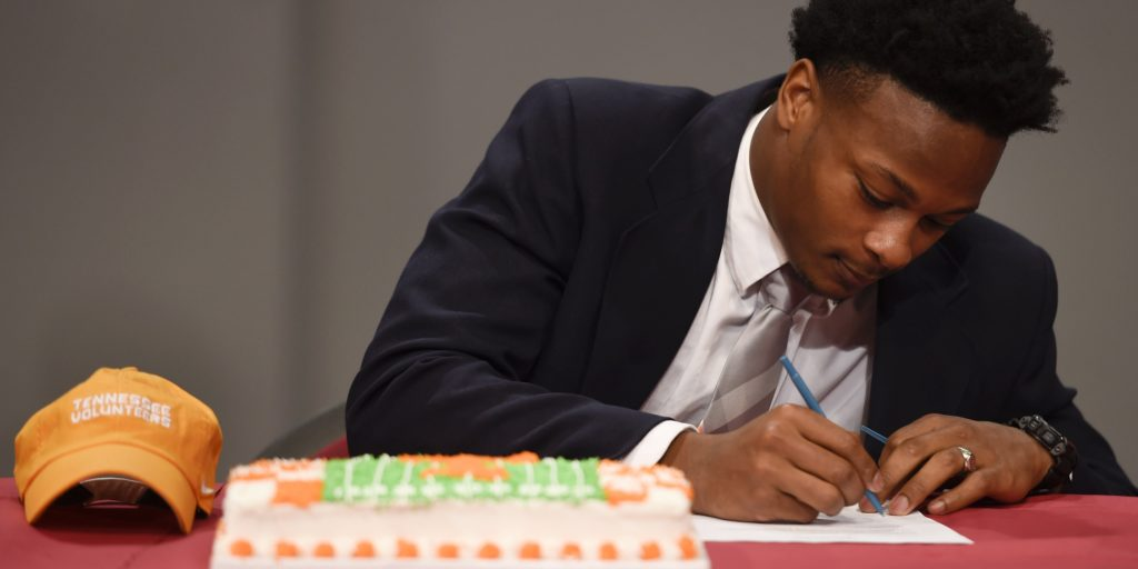 Feb 1, 2017; Nashville, TN, USA; Montgomery Bell Academy running back Ty Chandler signs his letter of intent to attend the University of Tennessee during National Signing Day. Mandatory Credit: George Walker IV / The Tennessean via USA TODAY NETWORK