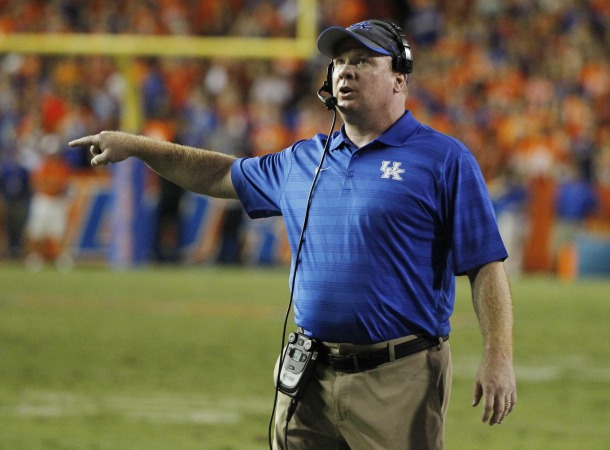 Sep 13, 2014; Gainesville, FL, USA; Kentucky Wildcats head coach Mark Stoops points during the second half against the Florida Gators at Ben Hill Griffin Stadium. Florida Gators defeated the Kentucky Wildcats 36-30. Mandatory Credit: Kim Klement-USA TODAY Sports