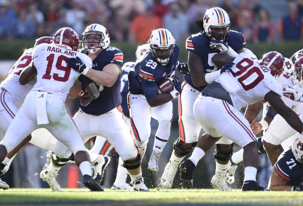 Nov 28, 2015; Auburn, AL, USA; Auburn Tigers running back Jovon Robinson (29) carries the ball between the blocks of Auburn Tigers offensive lineman Avery Young (56) and Alex Kozan (63) past Alabama Crimson Tide linebacker Reggie Ragland (19) and Jarran Reed (90) at Jordan Hare Stadium. Mandatory Credit: RVR Photos-USA TODAY Sports