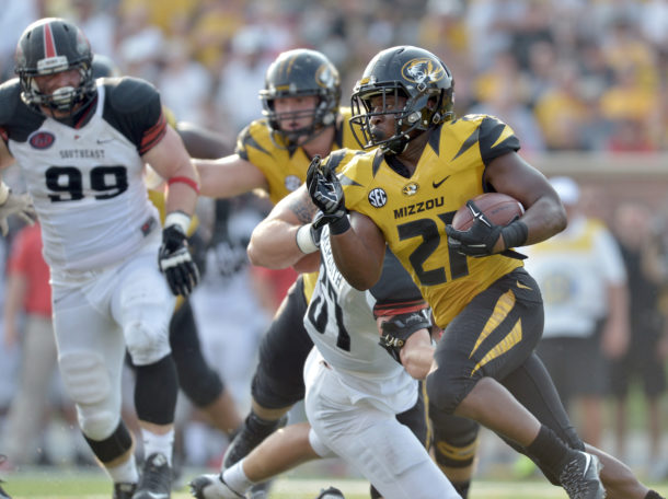 Sep 5, 2015; Columbia, MO, USA; Missouri Tigers running back Ish Witter (21) runs the ball during the second half against the Southeast Missouri State Redhawks at Faurot Field. Missouri won 34-3. Mandatory Credit: Denny Medley-USA TODAY Sports