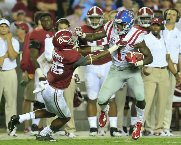 Sep 19, 2015; Tuscaloosa, AL, USA; Mississippi Rebels wide receiver Laquon Treadwell (1) pushes away Alabama Crimson Tide defensive back Marlon Humphrey (26) at Bryant-Denny Stadium. The Rebels defeated the Tide 43-37. Mandatory Credit: Marvin Gentry-USA TODAY Sports