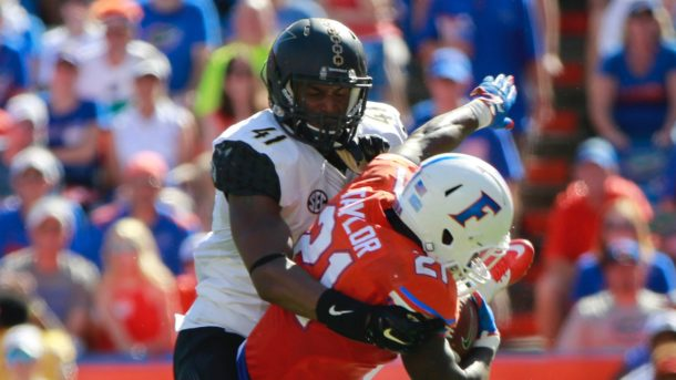 Nov 7, 2015; Gainesville, FL, USA; Florida Gators running back Kelvin Taylor (21) runs with the ball as Vanderbilt Commodores linebacker Zach Cunningham (41) tackles during the first half at Ben Hill Griffin Stadium. Mandatory Credit: Kim Klement-USA TODAY Sports