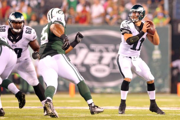 Sep 3, 2015; East Rutherford, NJ, USA; Philadelphia Eagles quarterback Tim Tebow (11) drops back to pass against the New York Jets during the fourth quarter of a preseason game at MetLife Stadium. The Jets defeated the Eagles 24-18. Mandatory Credit: Brad Penner-USA TODAY Sports