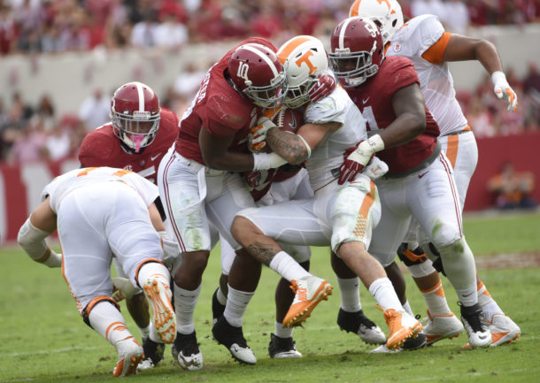 Oct 24, 2015; Tuscaloosa, AL, USA; Alabama Crimson Tide linebacker Reuben Foster (10) , linebacker Denzel Devall (30) and defensive lineman Dalvin Tomlinson (54) wrap up Tennessee Volunteers running back Jalen Hurd (1) during the second quarter at Bryant-Denny Stadium. Mandatory Credit: John David Mercer-USA TODAY Sports