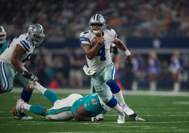 Aug 19, 2016; Arlington, TX, USA; Dallas Cowboys quarterback Dak Prescott (4) runs from Miami Dolphins defensive Deandre Coleman (62) during the second quarter at AT&T Stadium. Mandatory Credit: Jerome Miron-USA TODAY Sports