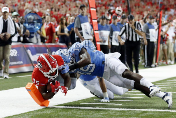Sep 3, 2016; Atlanta, GA, USA; Georgia Bulldogs running back Brian Herrien (35) dives for a touchdown against North Carolina Tar Heels safety Donnie Miles (15) during the second quarter of the 2016 Chick-Fil-A Kickoff game at Georgia Dome. Mandatory Credit: Jason Getz-USA TODAY Sports