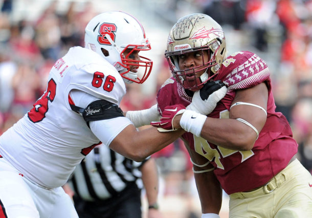 Nov 14, 2015; Tallahassee, FL, USA; Florida State Seminoles defensive end Demarcus Walker (44) battles at the line against North Carolina State Wolfpack offensive tackle Will Richardson (66) during the second half of the game at Doak Campbell Stadium. Mandatory Credit: Melina Vastola-USA TODAY Sports