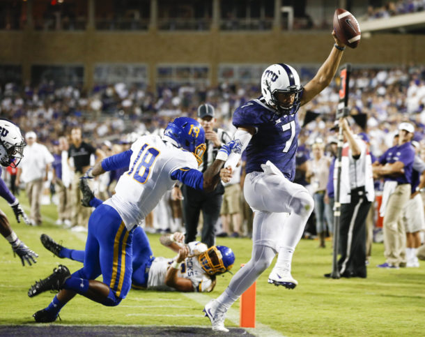Sep 3, 2016; Fort Worth, TX, USA; TCU Horned Frogs quarterback Kenny Hill (7) rushes in to score past South Dakota State Jackrabbits defensive back Marshon Harris (18) during the second half on an NCAA football game at Amon G. Carter Stadium. TCU won 59-41. Mandatory Credit: Jim Cowsert-USA TODAY Sports