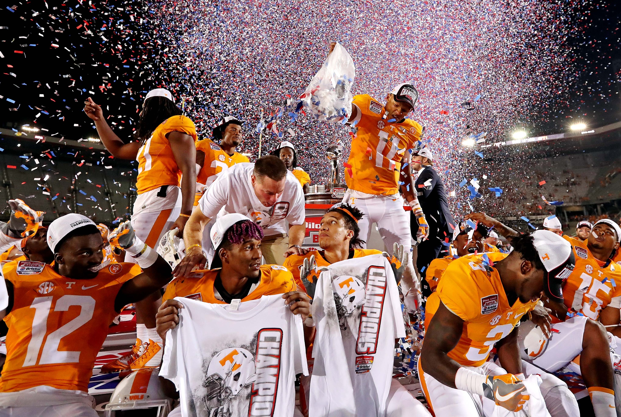 Sep 10, 2016; Bristol, TN, USA; Tennessee Volunteers quarterback Joshua Dobbs (11) dumbs confetti on his teammates after beating the Virginia Tech Hokies at Bristol Motor Speedway. Mandatory Credit: Peter Casey-USA TODAY Sports