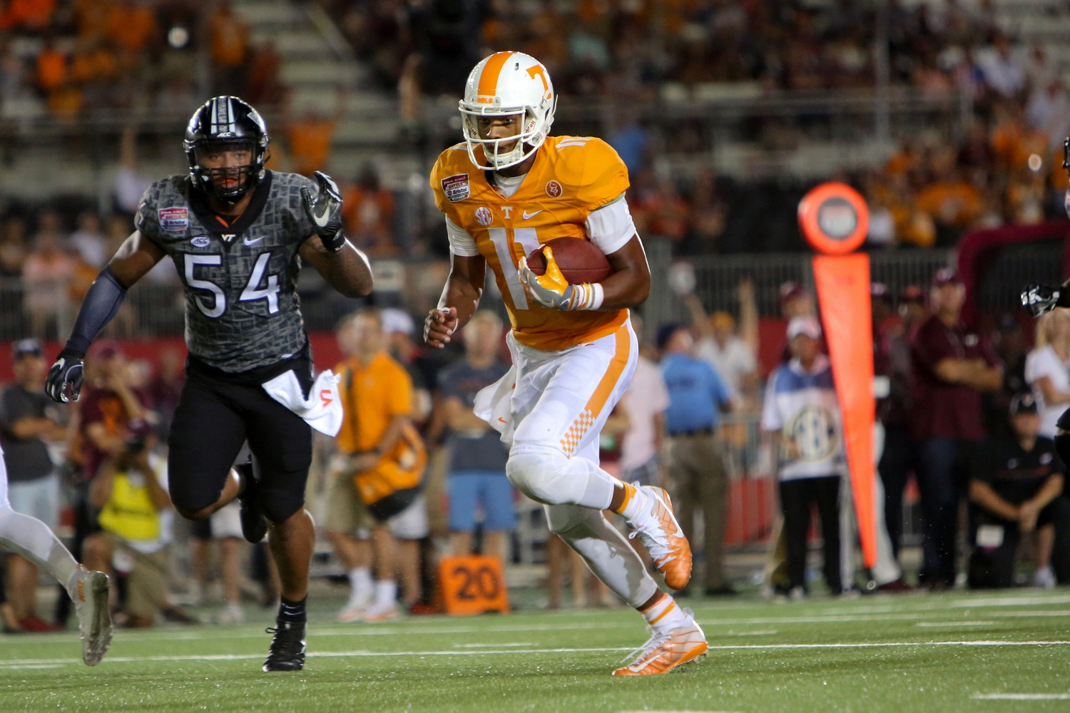 Sep 10, 2016; Bristol, TN, USA; Tennessee Volunteers quarterback Joshua Dobbs (11) runs the ball against the Virginia Tech Hokies during the second half at Bristol Motor Speedway. Tennessee won 45 to 24. Mandatory Credit: Randy Sartin-USA TODAY Sports