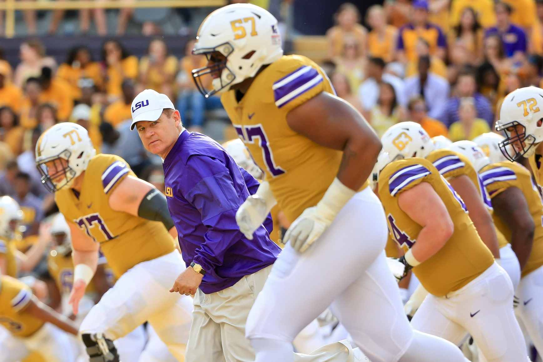 Sep 17, 2016; Baton Rouge, LA, USA; LSU Tigers head coach Les Miles runs onto the field with his team before a game against the Mississippi State Bulldogs at Tiger Stadium. Mandatory Credit: Derick E. Hingle-USA TODAY Sports