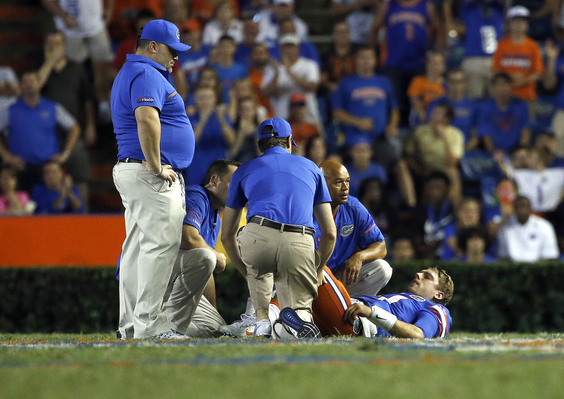 Sep 17, 2016; Gainesville, FL, USA; Florida Gators quarterback Luke Del Rio (14) gets checked out by trainers on the field and then leaves the game against the North Texas Mean Green during the second half at Ben Hill Griffin Stadium. Florida Gators defeated the North Texas Mean Green 32-0. Mandatory Credit: Kim Klement-USA TODAY Sports