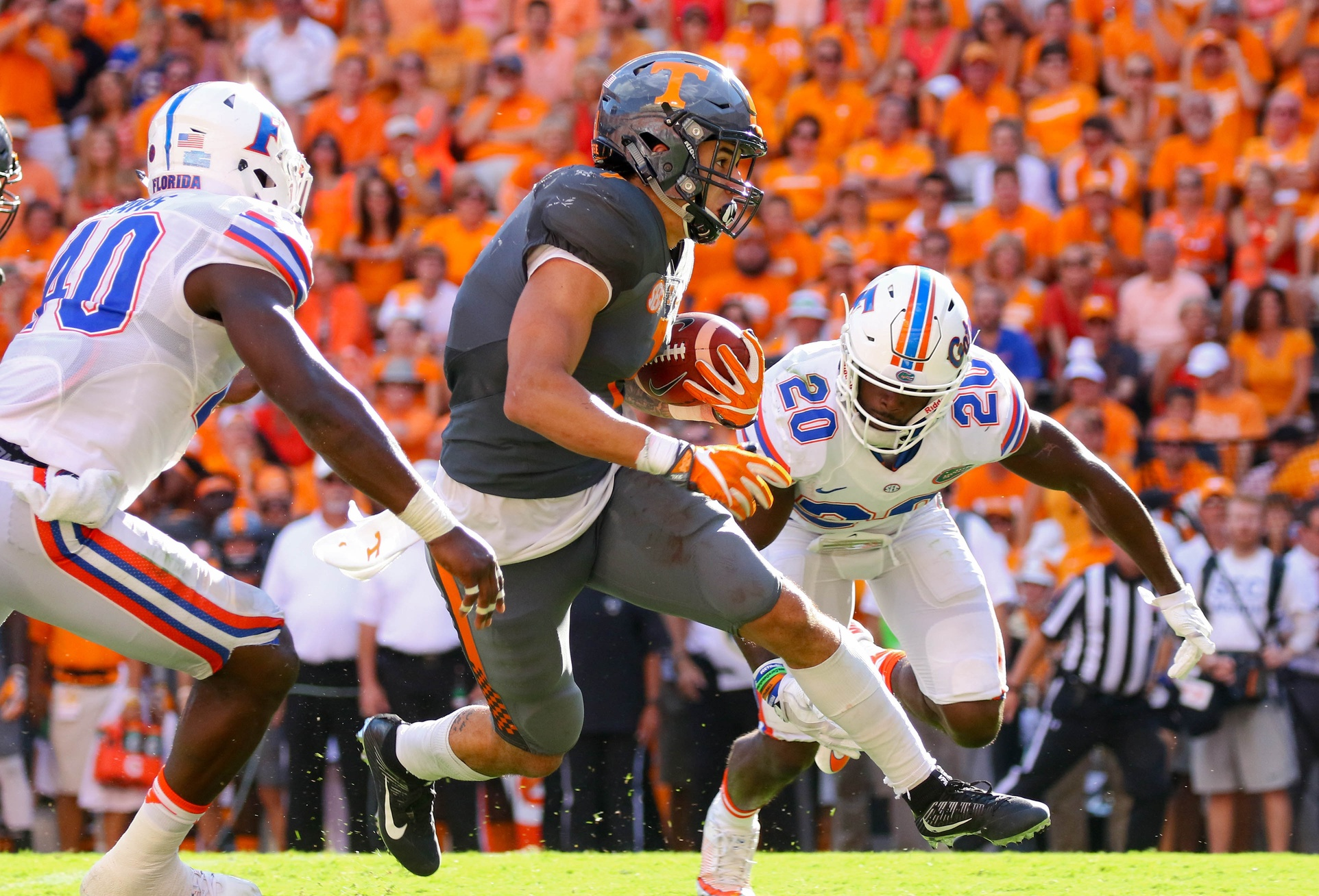 Sep 24, 2016; Knoxville, TN, USA; Tennessee Volunteers running back Jalen Hurd (1) runs the ball against Florida Gators defensive back Marcus Maye (20) during the second quarter at Neyland Stadium. Mandatory Credit: Randy Sartin-USA TODAY Sports