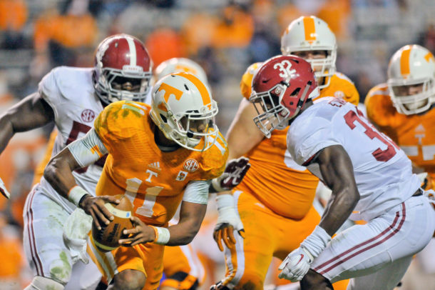 Oct 25, 2014; Knoxville, TN, USA; Tennessee Volunteers quarterback Joshua Dobbs (11) rushes against Alabama Crimson Tide linebacker Rashaan Evans (32) during the second half game at Neyland Stadium. Alabama won 34-20. Mandatory Credit: Jim Brown-USA TODAY Sports