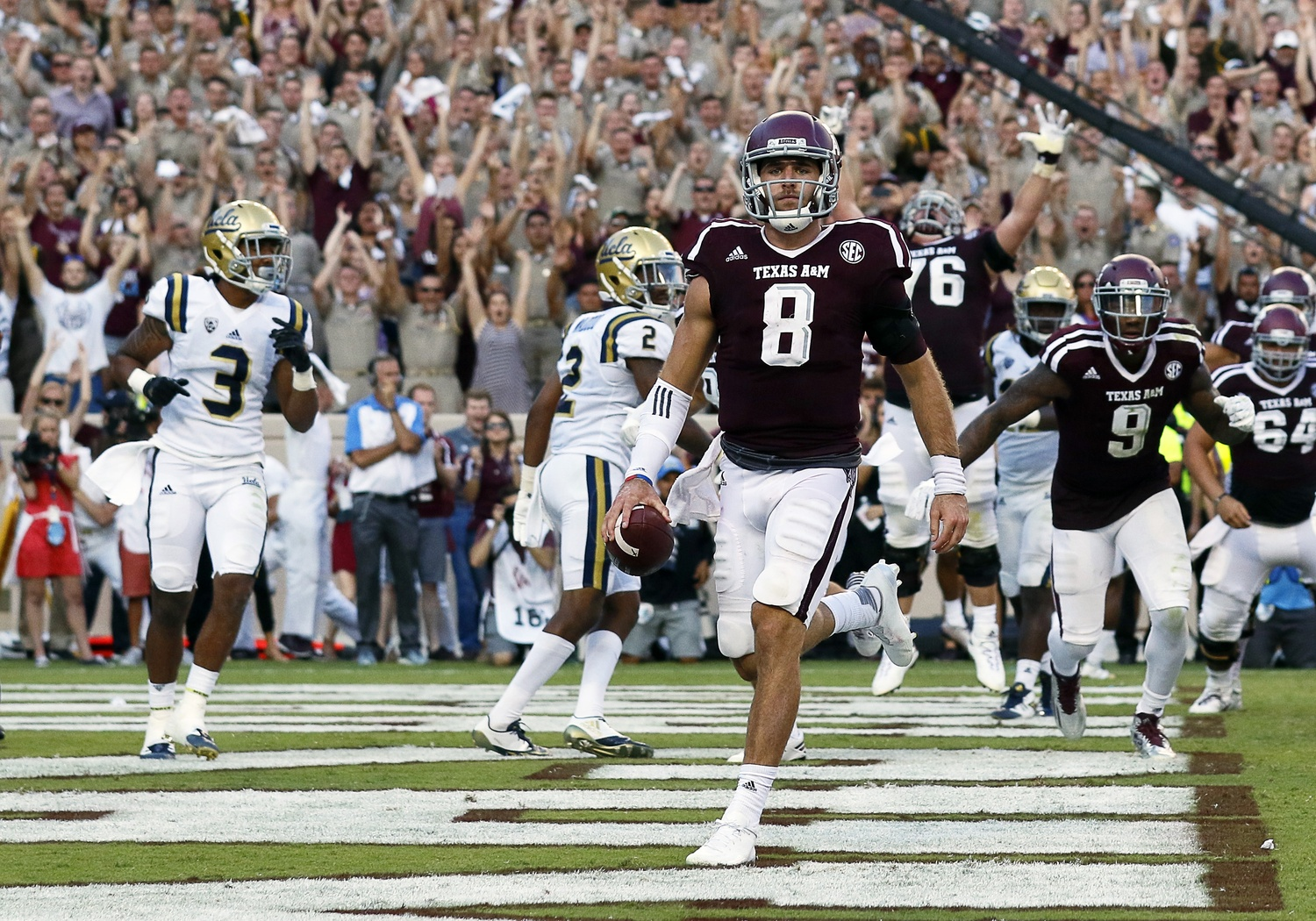 Sep 3, 2016; College Station, TX, USA; Texas A&M Aggies quarterback Trevor Knight (8) goes in for the one-yard touchdown run in overtime against the UCLA Bruins. Texas A&M won 31-24. Mandatory Credit: Ray Carlin-USA TODAY Sports