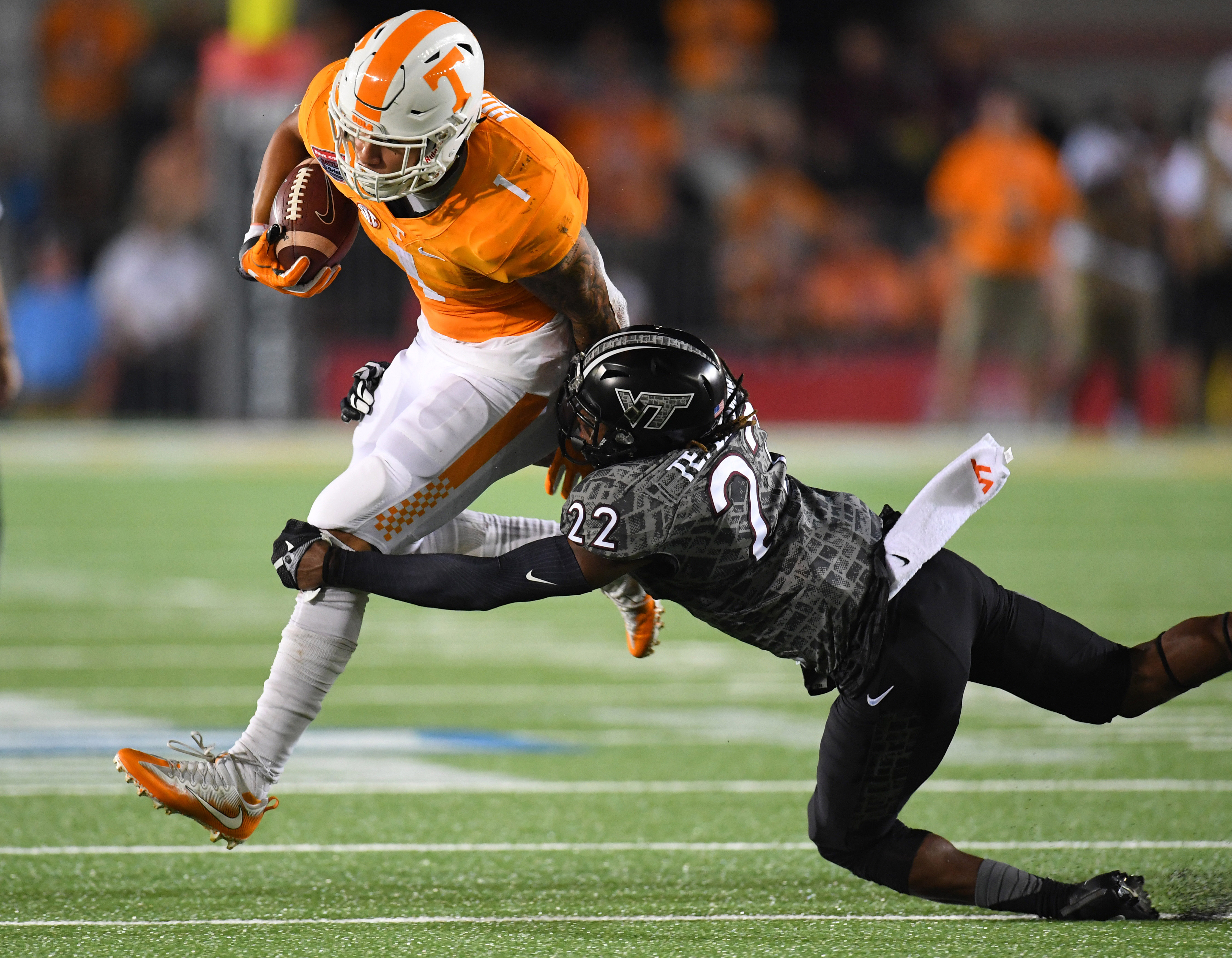 Sep 10, 2016; Bristol, TN, USA; Tennessee Volunteers running back Jalen Hurd (1) runs for a short gain while being tackled by Virginia Tech Hokies defensive back Terrell Edmunds (22) during the first half at Bristol Motor Speedway. Mandatory Credit: Christopher Hanewinckel-USA TODAY Sports