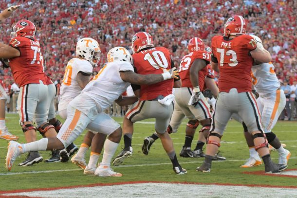 Oct 1, 2016; Athens, GA, USA; Tennessee Volunteers defensive end Derek Barnett (9) hits Georgia Bulldogs quarterback Jacob Eason (10) causing a fumble recovered by Tennessee for a touchdown during the fourth quarter at Sanford Stadium. Tennessee defeated Georgia 34-31. Mandatory Credit: Dale Zanine-USA TODAY Sports