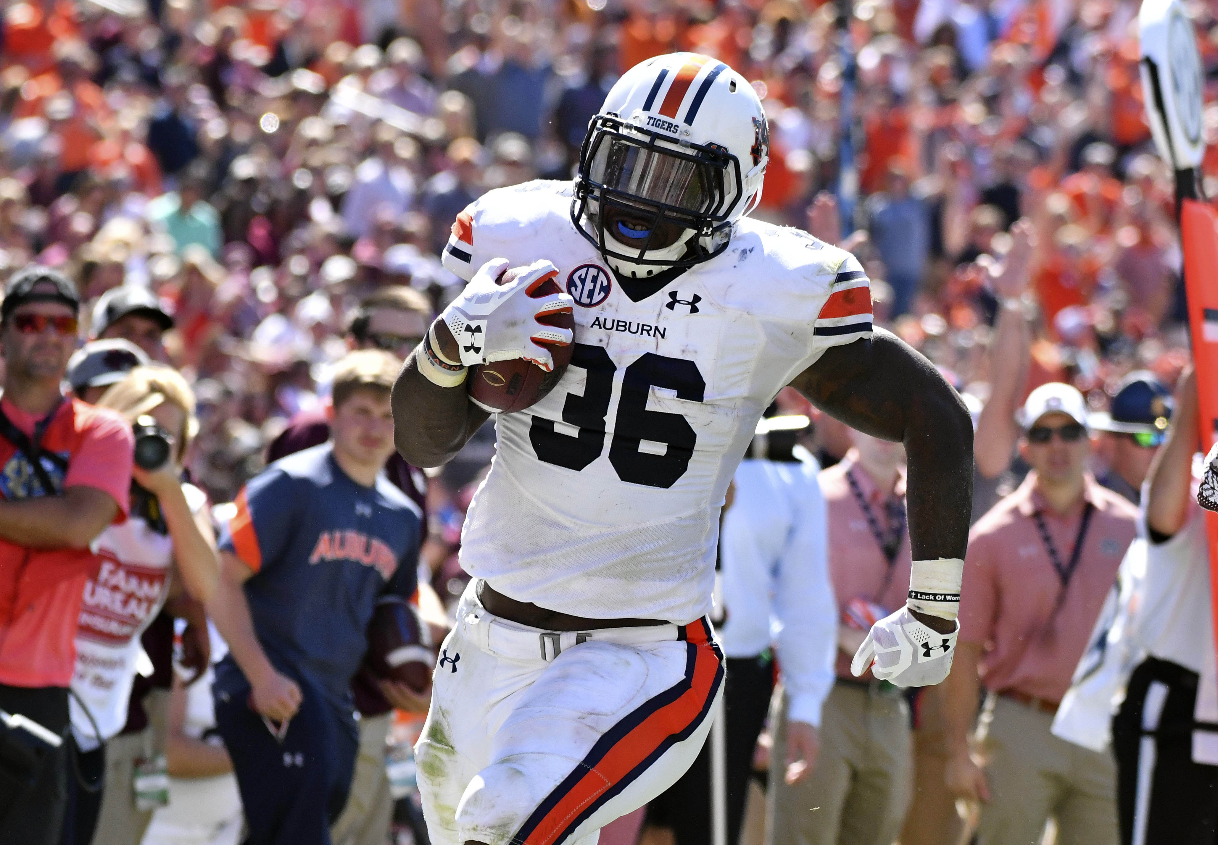 Oct 8, 2016; Starkville, MS, USA; Auburn Tigers running back Kamryn Pettway (36) runs the ball during the second quarter of the game against the Mississippi State Bulldogs at Davis Wade Stadium. Mandatory Credit: Matt Bush-USA TODAY Sports