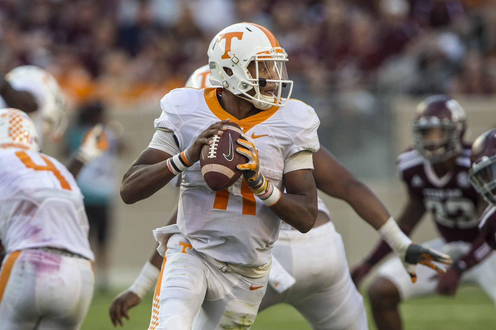 Oct 8, 2016; College Station, TX, USA; Tennessee Volunteers quarterback Joshua Dobbs (11) rolls out to pass against the Texas A&M Aggies during the second half at Kyle Field. The Aggies defeated the Volunteers 45-38 in overtime. Mandatory Credit: Jerome Miron-USA TODAY Sports