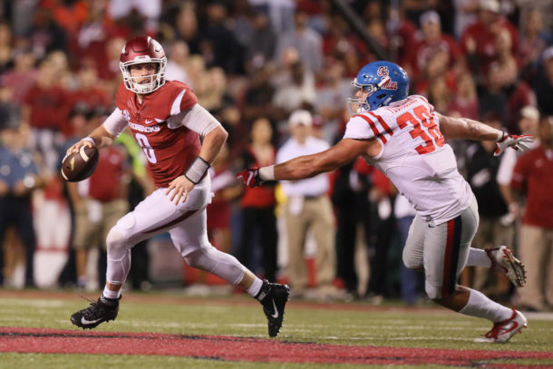 Oct 15, 2016; Fayetteville, AR, USA; Arkansas Razorbacks quarterback Austin Allen (8) is pressured by Ole Miss Rebels defensive end John Youngblood (38) during the second half at Donald W. Reynolds Razorback Stadium. Arkansas defeated Ole Miss 34-30. Mandatory Credit: Nelson Chenault-USA TODAY Sports