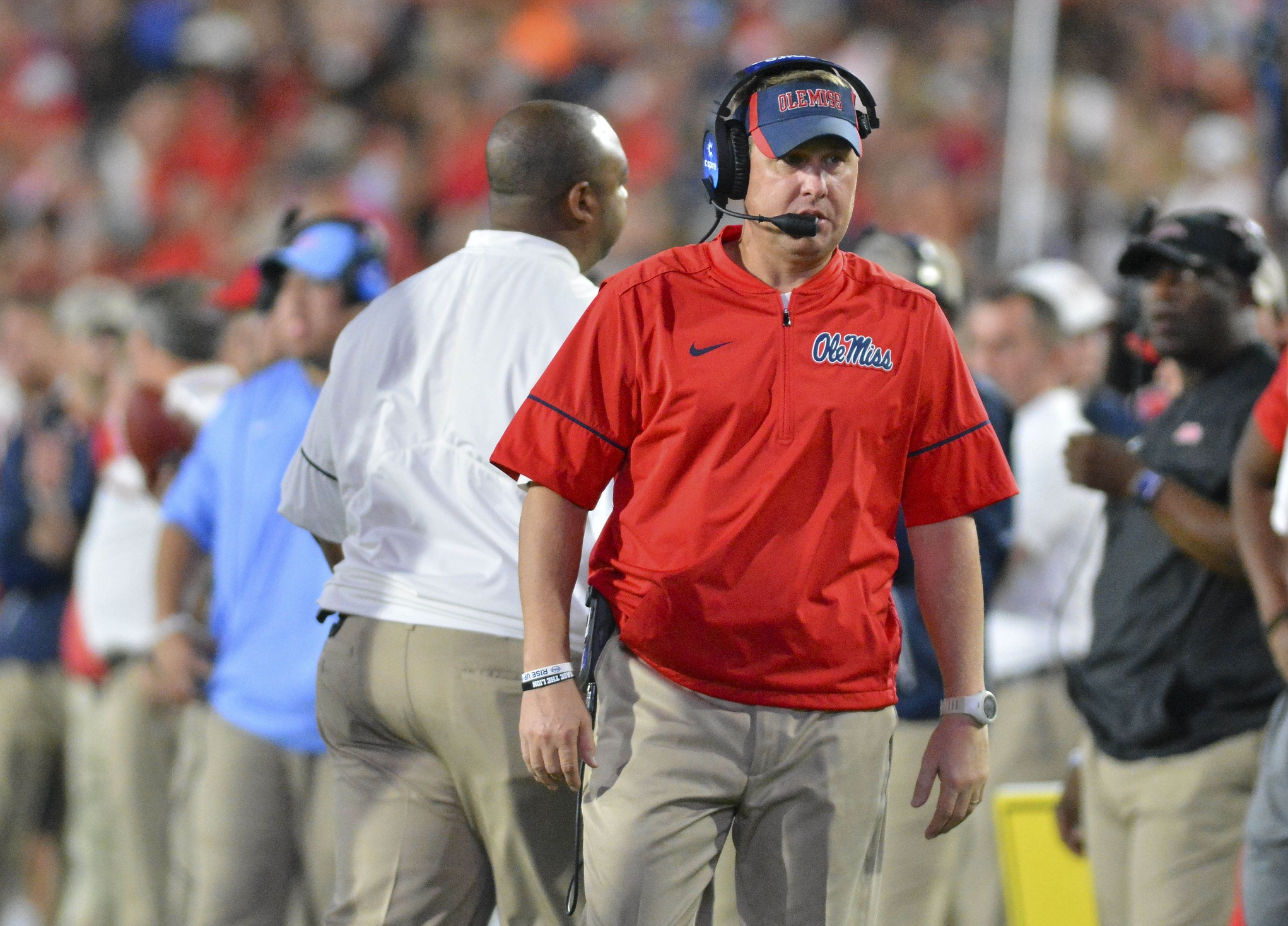 Oct 29, 2016; Oxford, MS, USA; Mississippi Rebels head coach Hugh Freeze talks into his headset during the second quarter of the game against the Auburn Tigers at Vaught-Hemingway Stadium. Mandatory Credit: Matt Bush-USA TODAY Sports