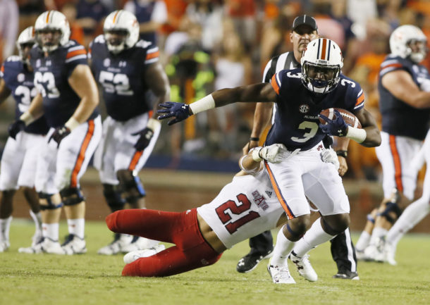 Sep 10, 2016; Auburn, AL, USA; Auburn Tigers receiver Nate Craig-Myers (3) is tackled by Arkansas State Red Wolves safety Cody Brown (21) during the third quarter at Jordan Hare Stadium. Mandatory Credit: John Reed-USA TODAY Sports