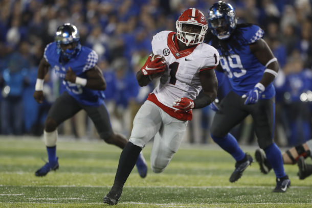 Nov 5, 2016; Lexington, KY, USA; Georgia Bulldogs running back Sony Michel (1) runs the ball against Kentucky Wildcats defensive back Adrian Middleton (99) in the second half at Commonwealth Stadium. Georgia defeated Kentucky 27-24. Mandatory Credit: Mark Zerof-USA TODAY Sports