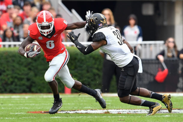Oct 15, 2016; Athens, GA, USA; Georgia Bulldogs wide receiver Riley Ridley (8) tries to prevent a tackle by Vanderbilt Commodores defensive back Bryce Lewis (30) during the first quarter at Sanford Stadium. Mandatory Credit: Dale Zanine-USA TODAY Sports