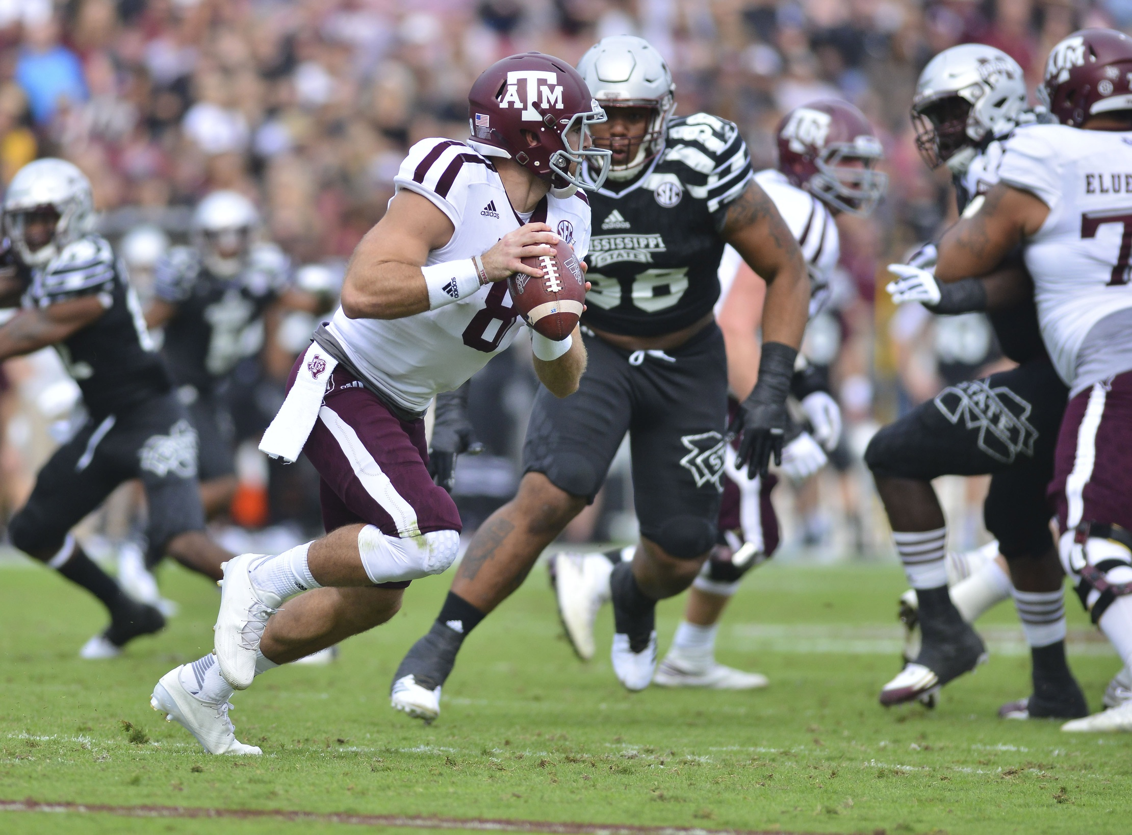 Nov 5, 2016; Starkville, MS, USA; Texas A&M Aggies quarterback Trevor Knight (8) moves in the pocket during the first quarter against the Mississippi State Bulldogs at Davis Wade Stadium. Mandatory Credit: Matt Bush-USA TODAY Sports