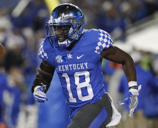 Nov 5, 2016; Lexington, KY, USA; Kentucky Wildcats running back Stanley Boom Williams (18) celebrates after scoring a touch down against the Georgia Bulldogs in the first half at Commonwealth Stadium. Mandatory Credit: Mark Zerof-USA TODAY Sports