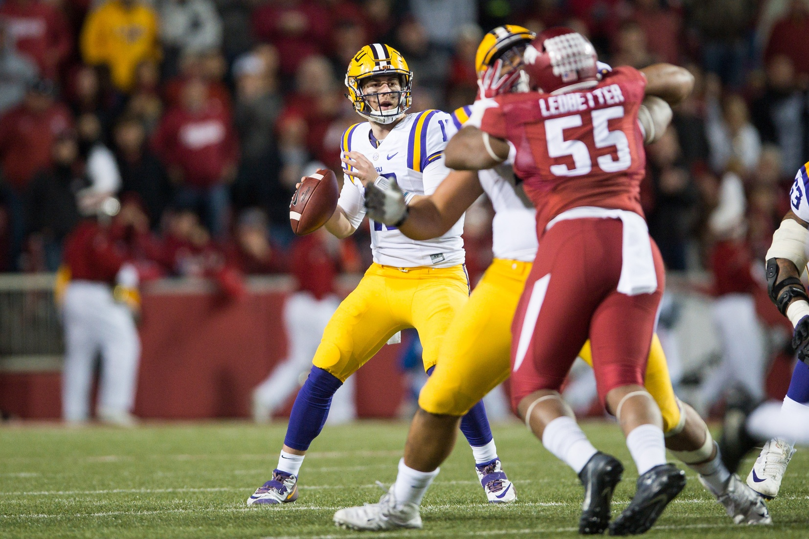 Nov 12, 2016; Fayetteville, AR, USA; LSU Tigers quarterback Danny  Etling (16) looks for a receiver as Arkansas Razorbacks defensive lineman <a rel=
