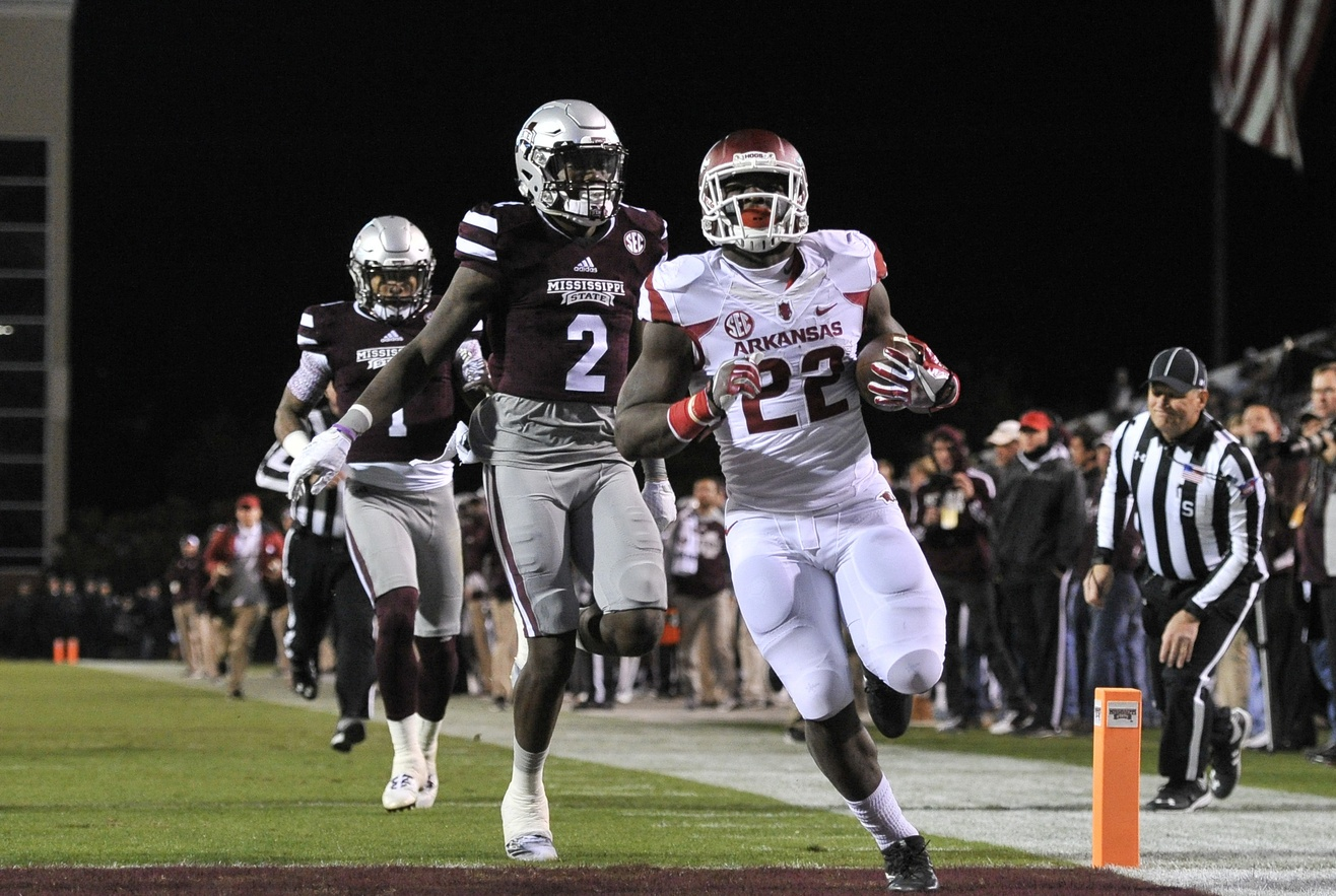 Nov 19, 2016; Starkville, MS, USA; Arkansas Razorbacks running back Rawleigh Williams III (22) scores a touchdown against Mississippi State Bulldogs defensive back Jamal Peters (2) during the first half at Davis Wade Stadium. Mandatory Credit: Justin Ford-USA TODAY Sports