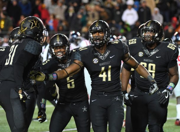 Nov 19, 2016; Nashville, TN, USA; Vanderbilt Commodores inside linebacker Zach Cunningham (41) is congratulated by teammates after a fumble recovery during the second half against the Mississippi Rebels at Vanderbilt Stadium. Vanderbilt won 38-17. Mandatory Credit: Christopher Hanewinckel-USA TODAY Sports