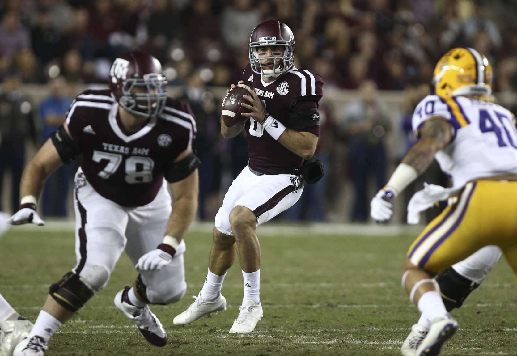 Nov 24, 2016; College Station, TX, USA; Texas A&M Aggies quarterback Trevor Knight (8) looks for an open receiver during the first half against the LSU Tigers at Kyle Field. Mandatory Credit: Troy Taormina-USA TODAY Sports